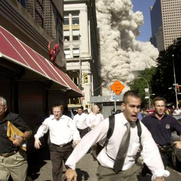 People Flee Collapsing World Trade Center Tower on 9/11